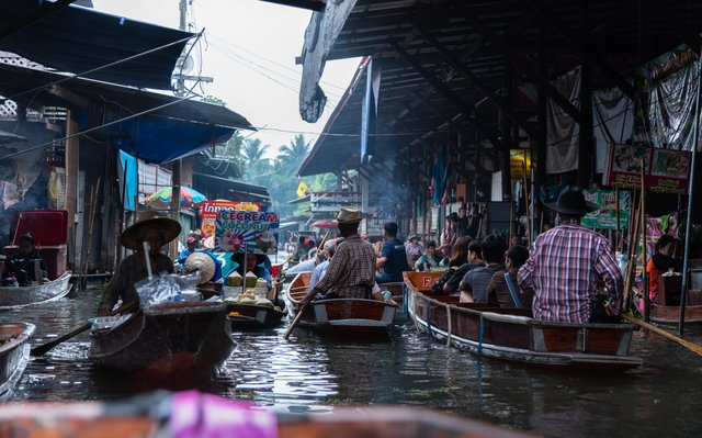 Market in Thailand where several locals sell their products on their boats