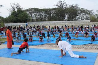 Photo: Pujya Abhayanandji teaching Surya Namaskar