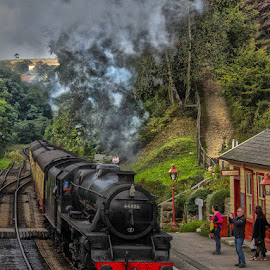 Train Arriving by Andrew Lancaster - Transportation Trains ( building, grass, travel, beauty, landscape, people, holiday, railway, locomotive, photographer, rail, train, lines, light, steam,  )