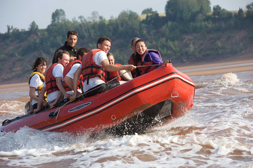 Ride the world's highest tide on a tidal bore rafting adventure on the Shubenacadie River in Halifax.
