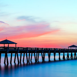 Juno Beach Pier Sunrise by Carl Albro - Buildings & Architecture Bridges & Suspended Structures ( water, dawn, pink sky, pier, sunrise )
