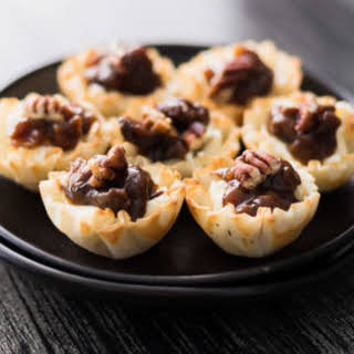 Bite Size Cheese Tart with Dried Fruit Chutney.