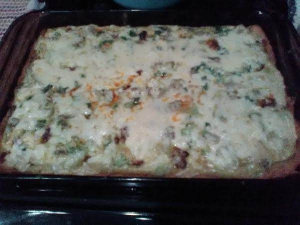 Gouda Cheese Smothers This Amazing Italian Sausage And Artichoke Quiche!