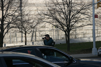 Photo: A guy in the middle of traffic taking a photo towards the Brooklyn Bridge Park.