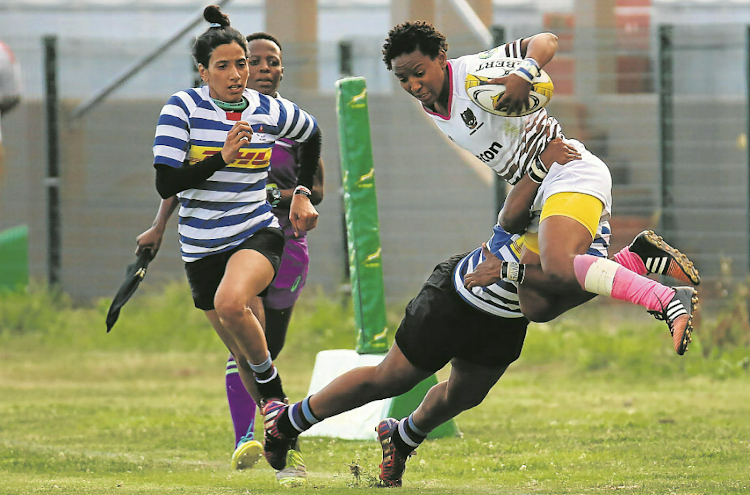 Border's Snenhlanhla Shozi is tackled by a Western Province player during the SA women's interprovincial tournament final at Buffalo City Stadium on Saturday. WP defended their title in a tough game.