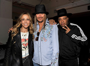 """Photo: DETROIT, MI - JANUARY 15:  (Exclusive Coverage)  Sheryl Crow, Kid Rock and Joseph """"Rev Run"""" Simmons backstage at Ford Field on January 15, 2011 in Detroit, Michigan.  (Photo by Kevin Mazur/WireImage)"""