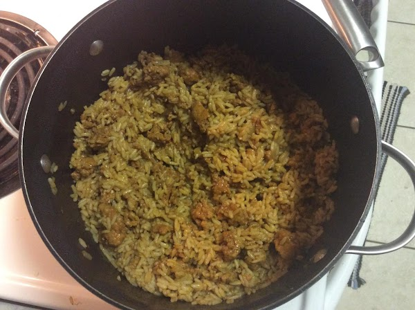Remove sausage from casing, & brown with diced onion in skillet. Add to rice...