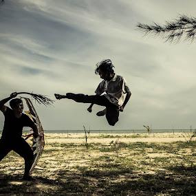 Battle of Kite Warrior and Deadly Kick Fighter by Putu Anggara - People Fine Art ( kick, kite, fighting, beach, borneo )