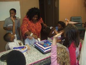 Photo: I begin to cut the cake