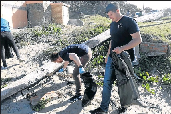 Corporate companies honour an invite from SAB to be part of the Corona Beach Clean-up held at the Eastern Beach.