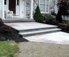 Photo: Bluestone treads with Versa-Lok risers http://northernlightslandscapecontractors.com