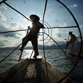 at work by Mike Mulligan - People Street & Candids ( inle lake, fishermen, myanmar, sunset, boats,  )