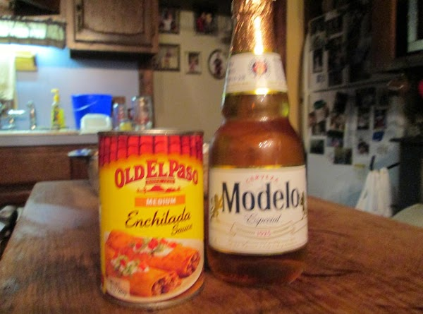 In a small bowl combine the beer and enchilada sauce, mix well, and then...
