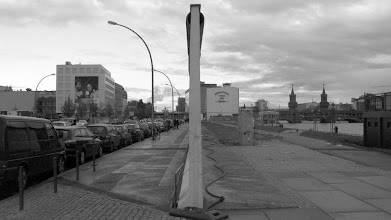 Photo: The wall still dividing west (left) from east (right) Berlin at Eastside gallery.