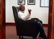 John Kani said the picture was taken a while ago while he was away.