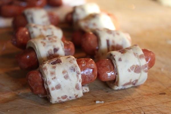 Roll a smokie up in each strip of cinnamon roll.