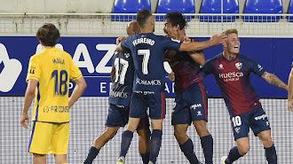 El Huesca celebrando el primer gol, obra de Cristo.