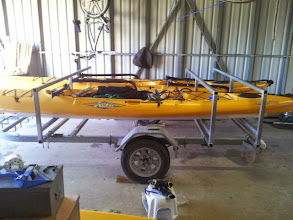 Photo: Custom cross bars have been mounted to the trailer frame. 3 meter pvc, 60mm pipe is just laying under the boats.