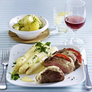 Pork Tenderloin with Asparagus and Hollandaise Sauce.