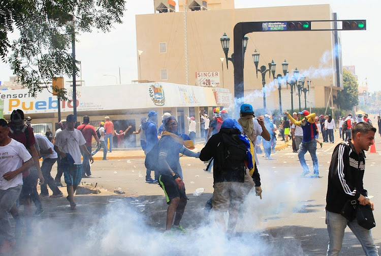 Opposition supporters clash with security forces during protests against unpopular leftist President Nicolas Maduro in Maracaibo, Venezuela. File Picture: REUTERS