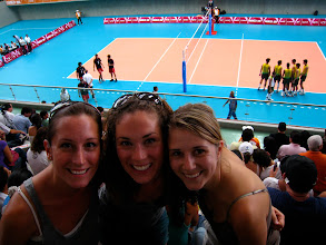 Photo: Marlo, Laura, and Marcela enjoying the Men's Volleyball game.