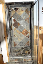 Photo: 1st floor shower with natural slate stone tiled throughout this full bath