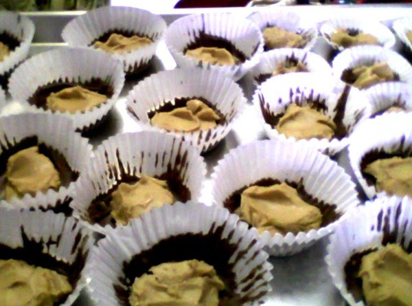 Melt more chocolate for the tops. Spoon the chilled peanut butter filling into each...