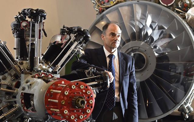VITAL COG: Rolls-Royce CEO Warren East poses next to airplane engines at the company's aerospace engineering site in Bristol in 2015. File picture: REUTERS