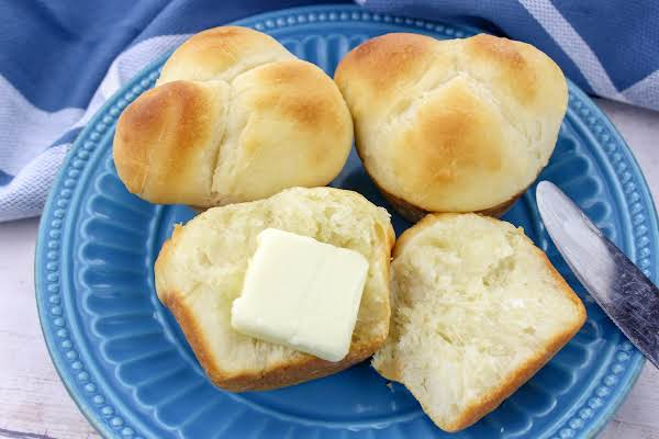 Modernized Old-fashioned Yeast Rolls With A Pat Of Butter.
