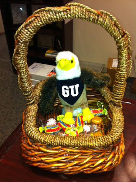 Photo: Check out our mascot, the Talon, in stuffed animal and miniature form at the front desk! Before taking candy, we all greet the little fella.
