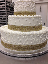 Photo: 3-tier cake featuring Town&Country w/dot border on top and bottom tiers, and single polka dots on middle tier. Gold ribbon wrap around each tier (provided by customer).