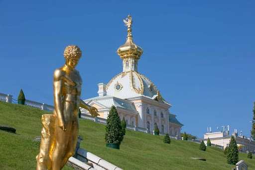 Peterhof-Palace-grounds-and-statue.jpg - The fountain gardens of Peterhof. 500 acres, 200+ statues, 144 fountains and a whole lot of decadence. Peterhof Palace near St. Petersburg, Russia.