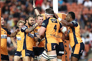 The Brumbies celebrate the try to Pete Samu during the round four Super Rugby match between the Chiefs and the Brumbies at FMG Stadium on February 22, 2020 in Hamilton, New Zealand.