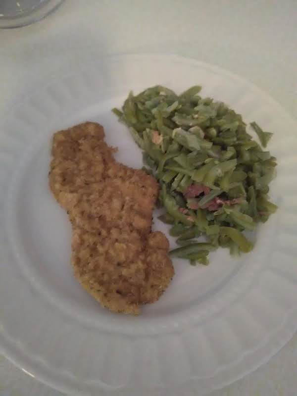 Schnitzel Piping Hot And Oh So Tender Served With Green Beans With Bacon.  Yum!