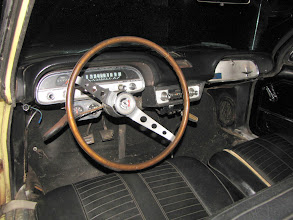 "Photo: Here is the coveted factory ""wood"" sport wheel. only one crack.  Owner installed Quick Steering arms, Oil Pressure and Amp gauges. Dash pad is perfect.  Quick shift is also installed along with a vintage T-handle shift knob."