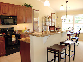 Photo: The kitchen and dining area in the BAYBERRY condominium.