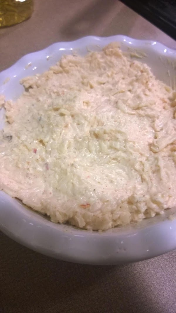 Mix cream cheese, pepper jack cheese, onion, mayonnaise, garlic powder, and paprika together in...