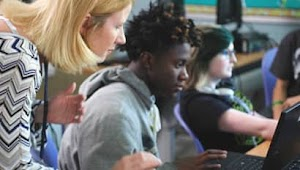 David Yabu, Teacher at Hillsboro High School ni Chicago, IL helping a student