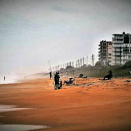 Fishing on Flager Beach by Priscilla Renda McDaniel - Landscapes Beaches ( condos, sand, beach. fishing, people,  )