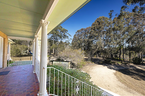 Photo of property at 18 Woodlands Drive, Hallidays Point 2430