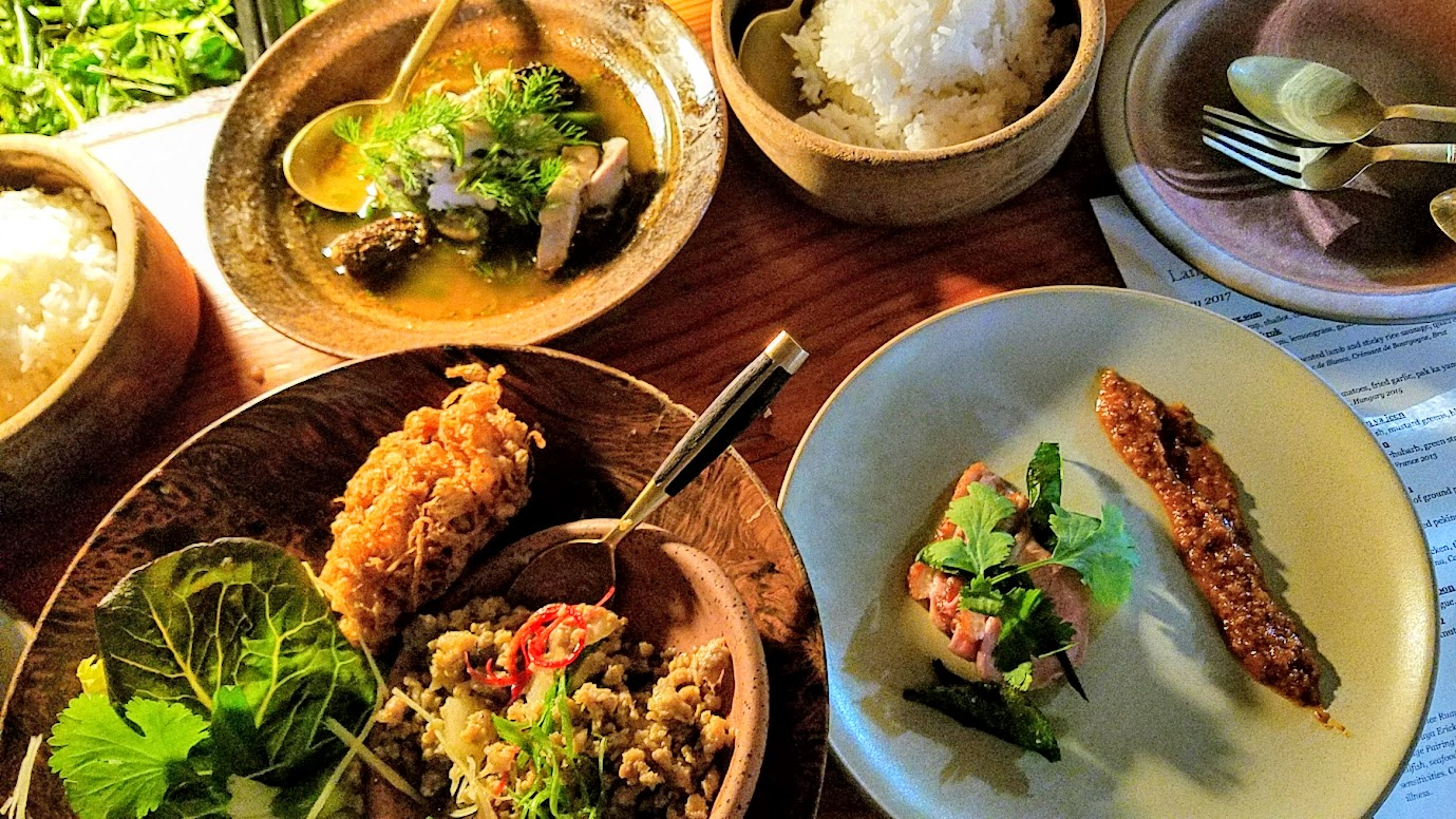 Journey of a Dinner at LangBaan with their May 2017 Tour of Thailand menu: The main course came as multiple dishes all at once to eat family style that included wraps, dish to eat with rice, soup.