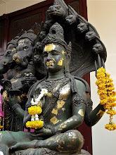Photo: Hindu deity on the grounds of Wat Traimitr