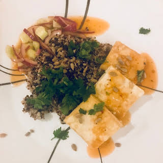 Crispy Tofu Quinoa Bowl with Pickled cucumber.