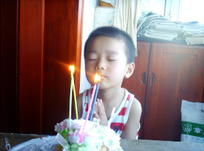 Photo: old photos from emakingir: baby son in praying with his birthday cake.