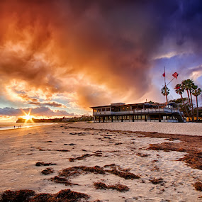 Brewing by Brandon Chapman - Landscapes Sunsets & Sunrises ( clouds, sand, orange, flags, yellow, beach, canon 7d, palms, santa barbara, blue, sunset, kelp, yacht club, sigma 10-20mm,  )