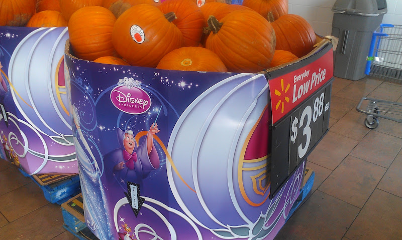 Photo: Just inside Walmart I saw not only pumpkins, but these adorable displays advertising Cinderella on DVD! I am so excited to see this again, but I have to convince Hubby that our boy will love it too. I might just have to sneak it in on the weekend. ;)