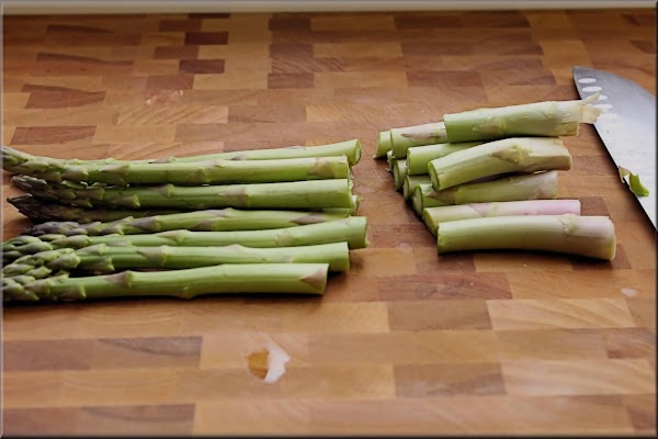 Prep asparagus - Place the asparagus on your cutting board and cut the tough...
