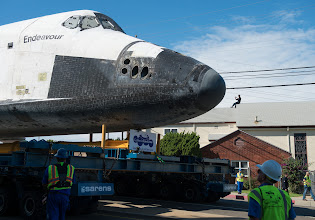Photo: A spectator on the roof of a building photographs space shuttle Endeavour as it passes by on its way to its new home at the California Science Center in Los Angeles, Friday, Oct. 12, 2012.  Endeavour, built as a replacement for space shuttle Challenger, completed 25 missions, spent 299 days in orbit, and orbited Earth 4,671 times while traveling 122,883,151 miles. Beginning Oct. 30, the shuttle will be on display in the CSC's Samuel Oschin Space Shuttle Endeavour Display Pavilion, embarking on its new mission to commemorate past achievements in space and educate and inspire future generations of explorers. Photo Credit: (NASA/Carla Cioffi)