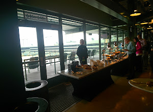 Photo: Agents enjoying the buffet with a great view of Lambeau field below.