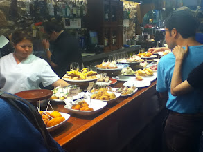 Photo: A bar in San Sebastion loaded with pinchos (smaller version of tapas).